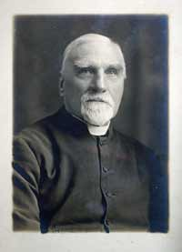 The Reverend Frederic Willet in dog-collar and cassock