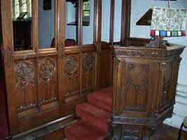 Photograph of pulpit and part of carved chancel screen