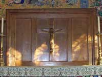 Wooden reredos with crucifix